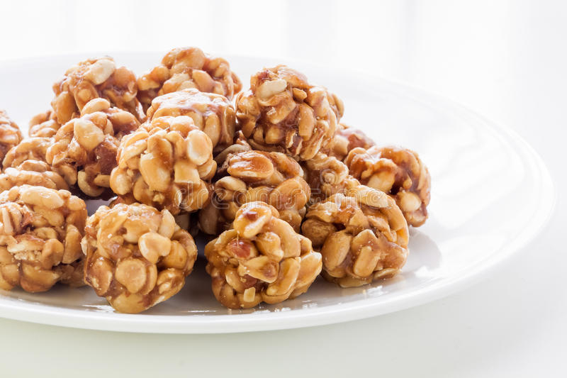Sweet peanut balls in a plate. On a table with natural light from window royalty free stock image