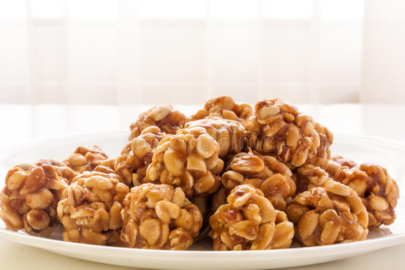 Sweet peanut balls in a plate. On a table with natural light from window royalty free stock photos