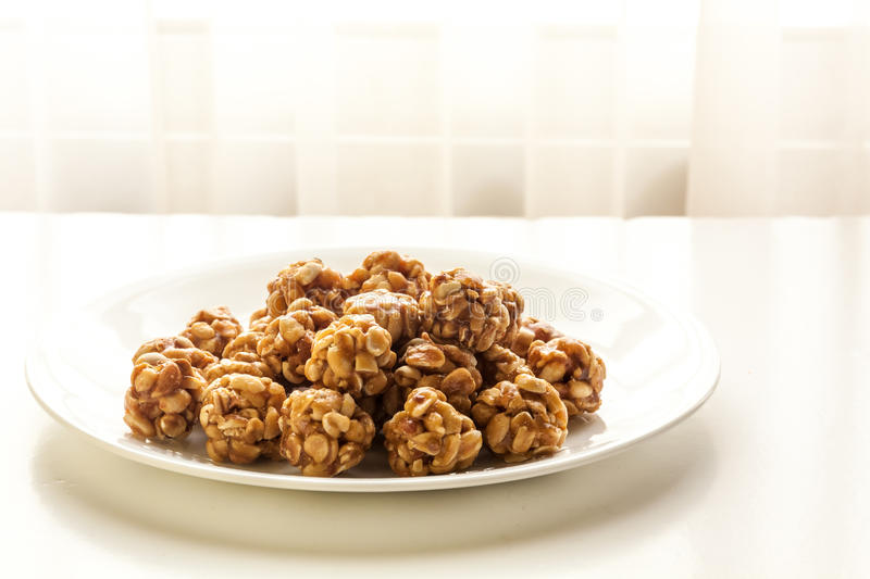 Sweet peanut balls in a plate. On a table with natural light from window stock photos