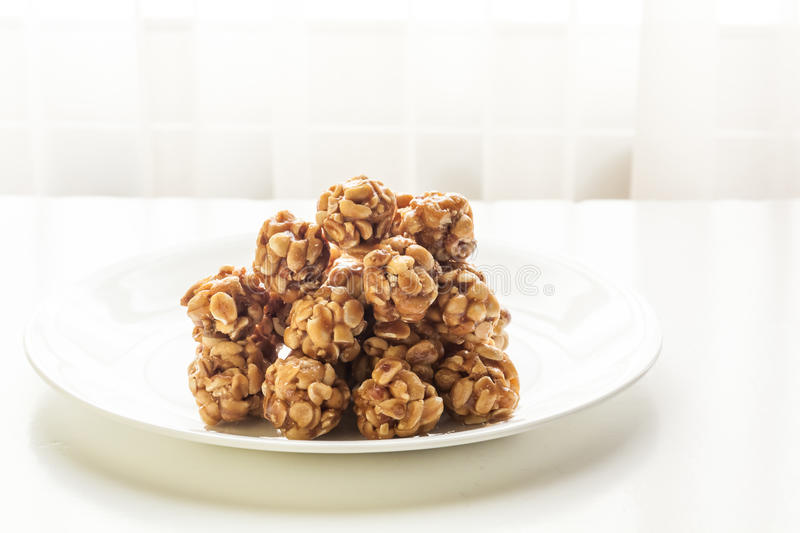 Sweet peanut balls in a plate. On a table with natural light from window royalty free stock photo