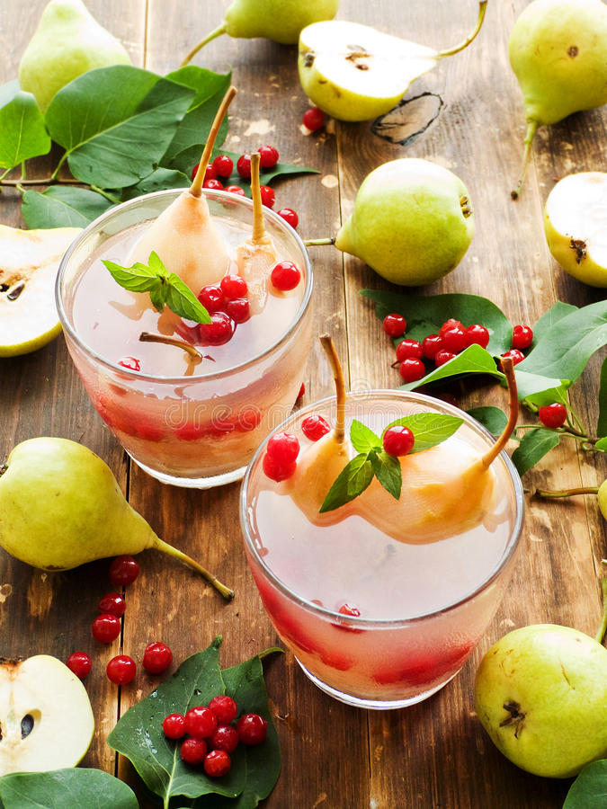 Sweet pear compote. Glasses with sweet pear cranberry compote and mint. Shallow dof royalty free stock images