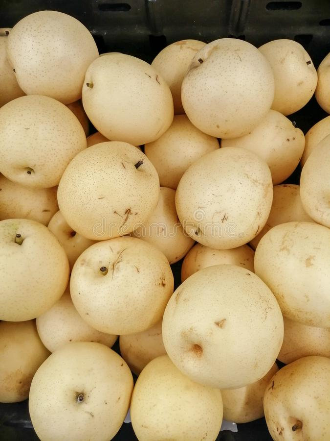 Bulk century pears in a grocery store stock photos