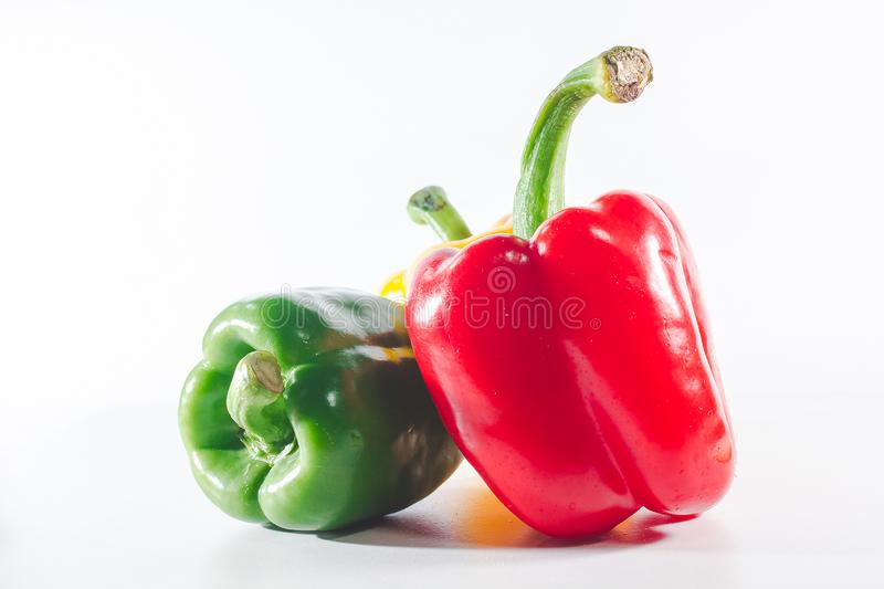 Sweet peppers are on a white background, royalty free stock photography