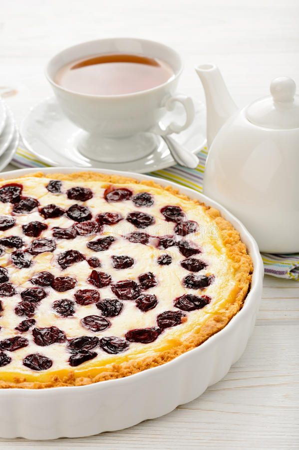Sweet pie baked with frozen cherries on wooden table. stock photography