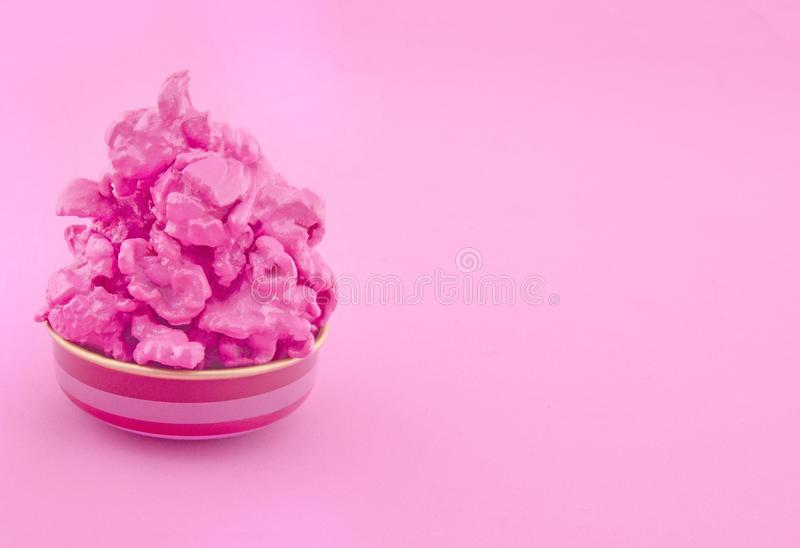 Sweet pink popcorn on paper background. Fashion pop art style. Top view. royalty free stock photos