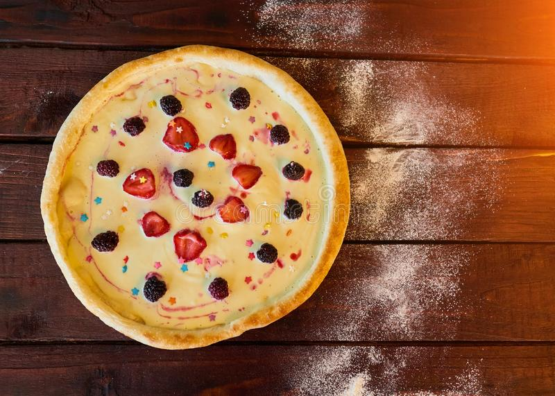 Sweet pizza with cream and fruit for children stock image