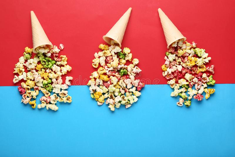 Sweet popcorn in waffles. On colorful background stock photos