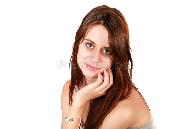 Sweet portrait of a pretty young woman with blue eyes and brown hair stock photo
