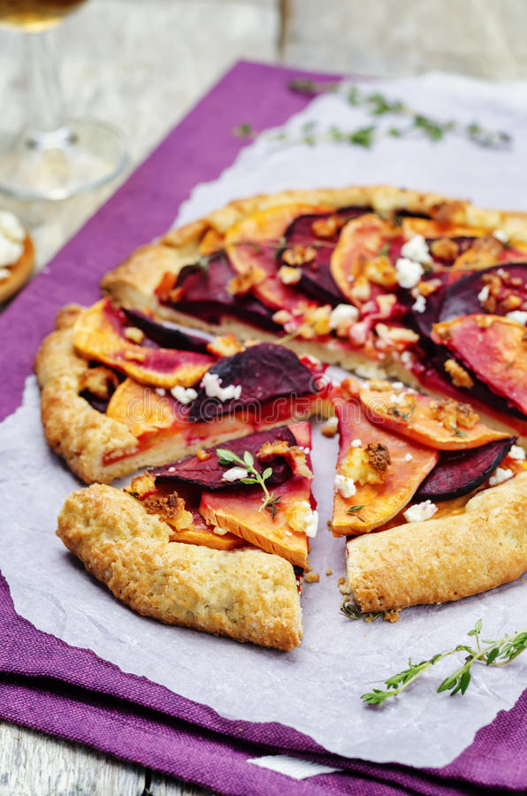 Sweet potato beets galette with goat cheese and thyme royalty free stock photos
