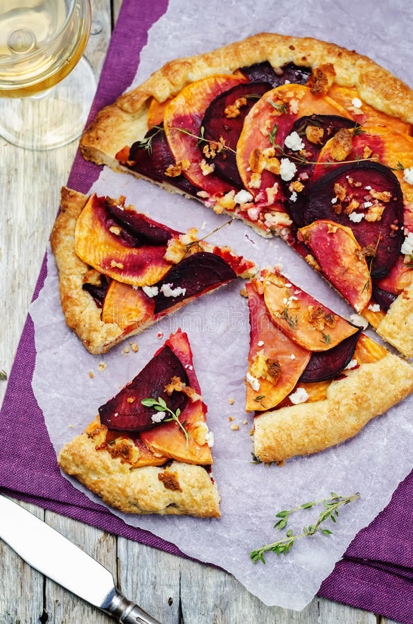 Sweet potato beets galette with goat cheese and thyme stock photo