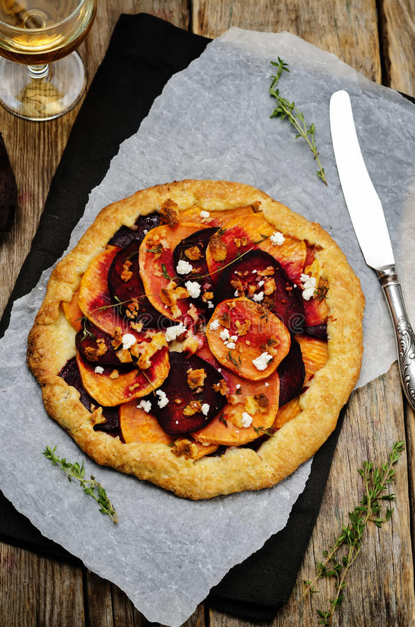 Sweet potato beets galette with goat cheese and thyme royalty free stock photo