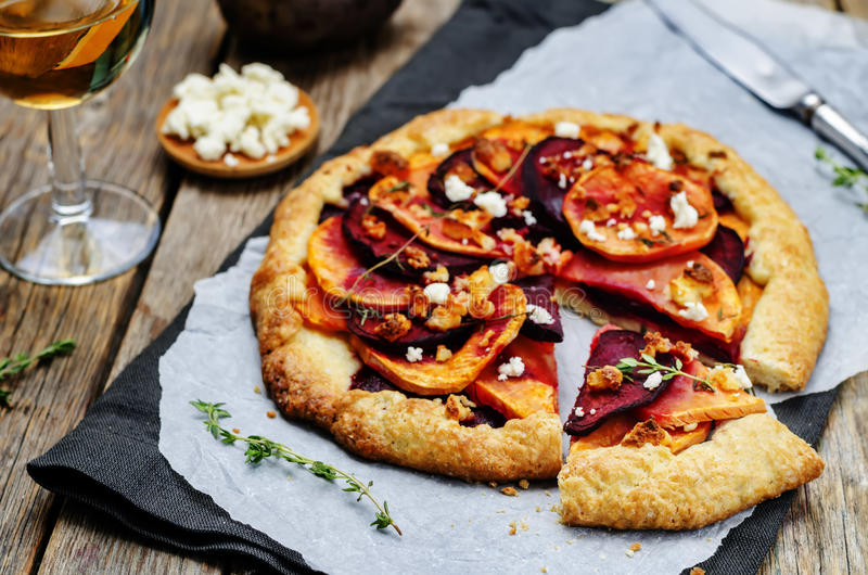 Sweet potato beets galette with goat cheese and thyme stock images