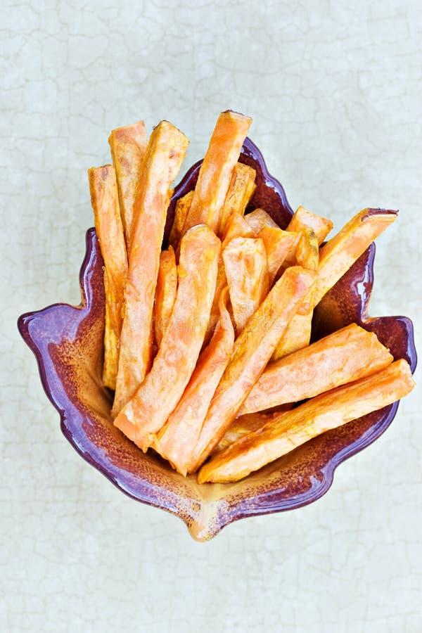 Sweet potato fries. In an autumn dish stock photography