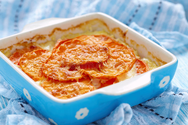 Sweet potato gratin. With cream in baking dish stock photo