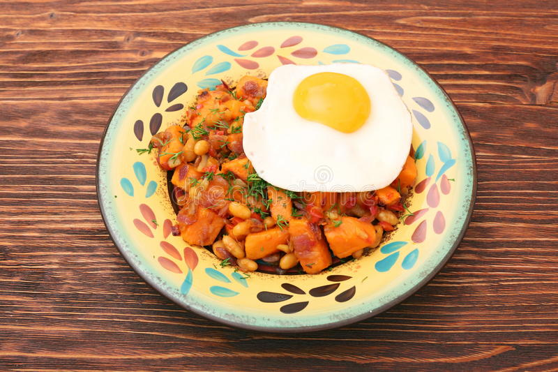 Sweet Potato Hash with Fresh Herbs, Peppers and Onions stock photos