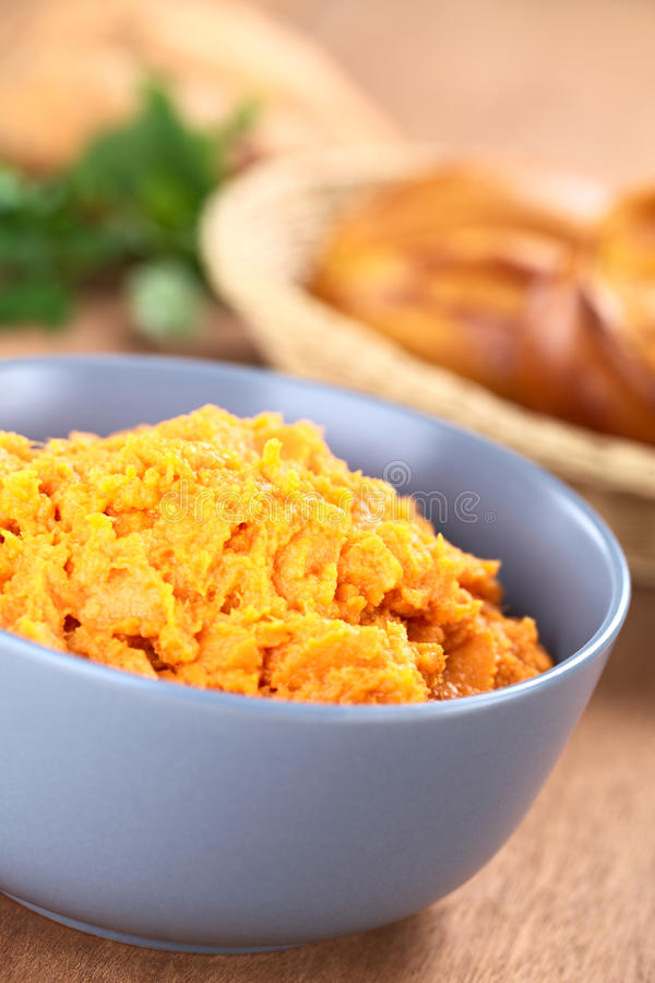Sweet Potato Spread. Bowl of sweet potato spread with sweet potato buns in bread basket in the back (Selective Focus, Focus one third into the spread royalty free stock photos