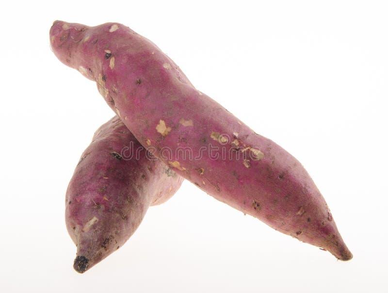 Sweet potatoes on background stock photography