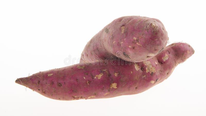 Sweet potatoes on background stock photos