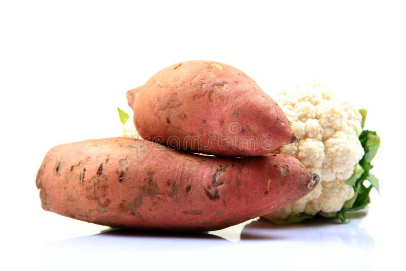 Sweet potatoes and cauliflower royalty free stock image