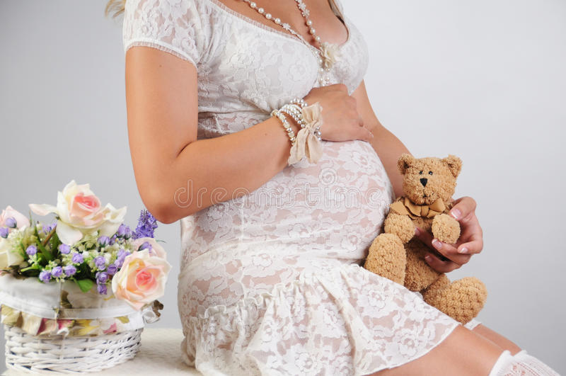 Sweet pregnancy. Belly of a pregnant woman. Photo taken in the studio stock image