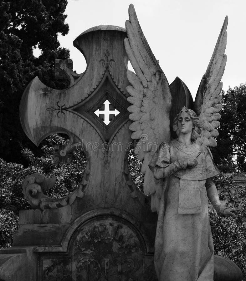 Sweet protecting angel part 3. Shot in black and white detail of the sculpture on the facade of this historic building cemetery representing some characters / stock image