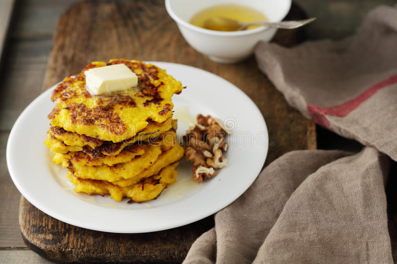 Sweet pumpkin pancakes with butter royalty free stock image