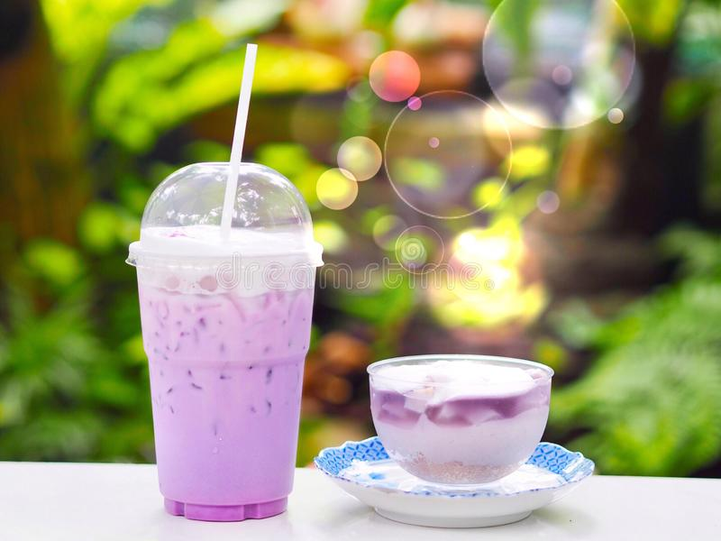 Sweet purple creamy ice and taro cup cake with bokeh copy space in garden background royalty free stock photo