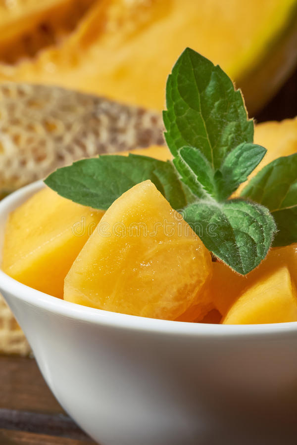 Sweet ripe cantaloupe. Melon cut and served with mint leaves stock images