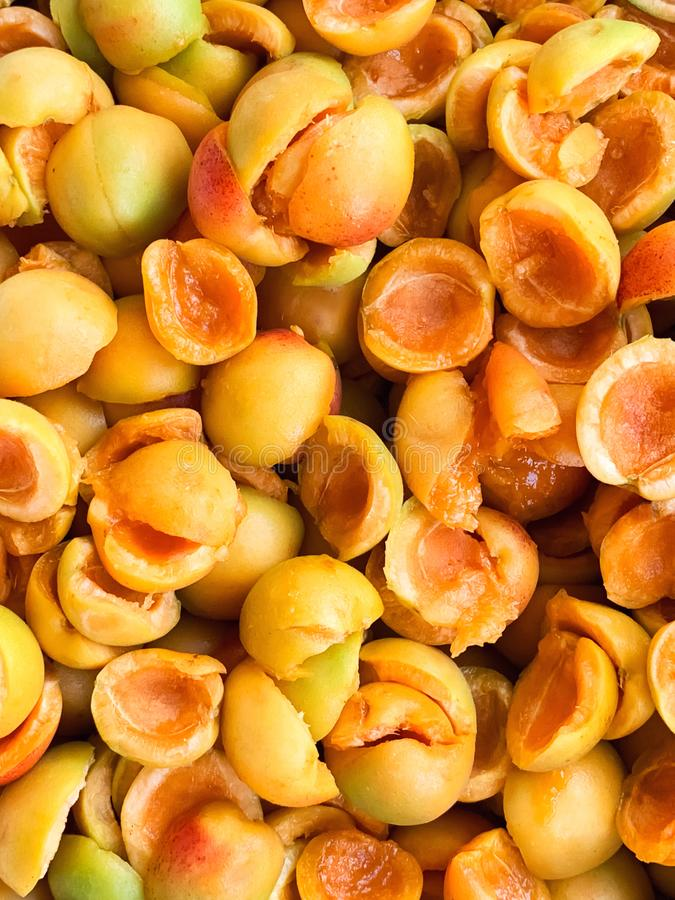 Sweet ripe juicy orange apricots. Fruit halves. The concept of the summer harvest, canning. Apricot day. Slices the workpiece to. Jam stock images