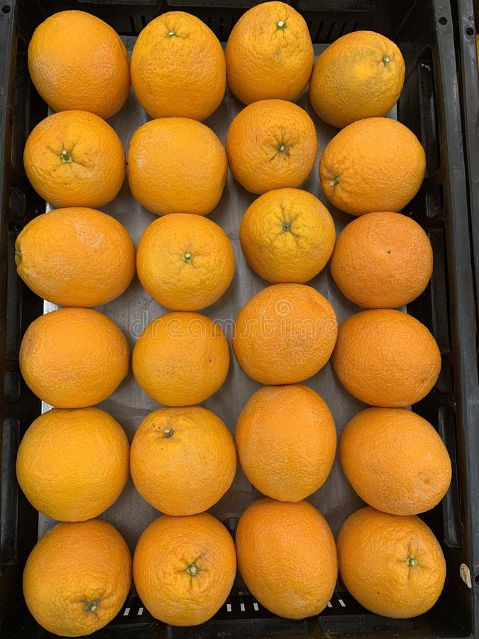 Sweet ripe oranges fruits on market close up stock photo
