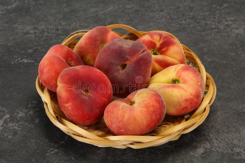 Sweet ripe tasty flat peach. Sweet ripe tasty few flat peaches royalty free stock photo