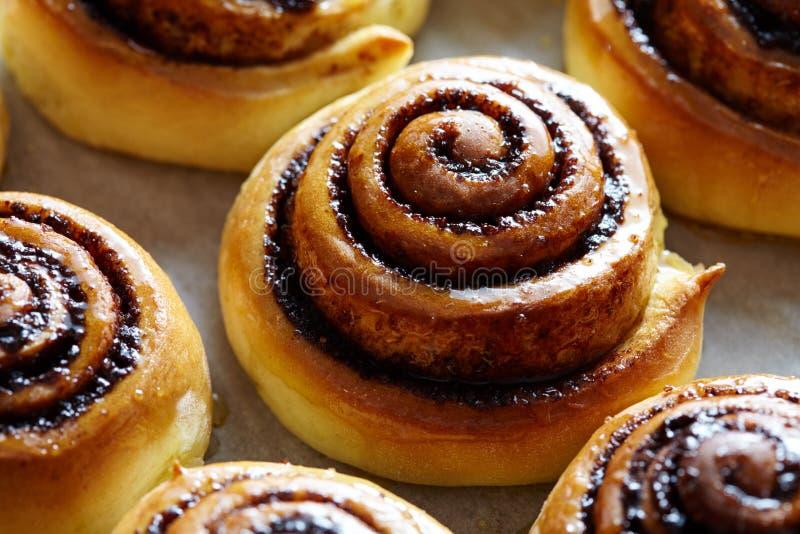 Sweet rolls with cinnamon and cocoa filling. Cinnabon roll bread, homemade bakery. Kanelbulle swedish dessert. stock photo