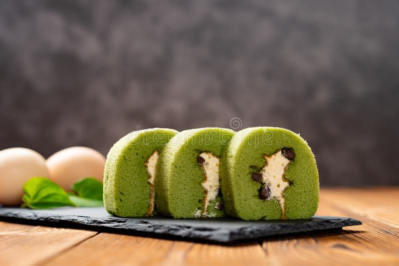 Sweet rolls made of green tea & mung bean with eggs on background royalty free stock photos