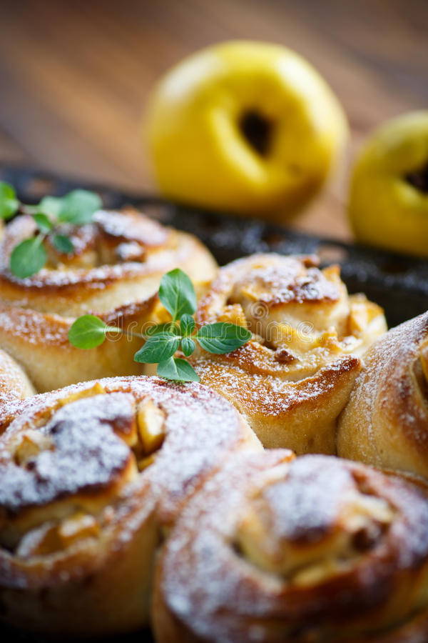 Sweet rolls with quince stock images