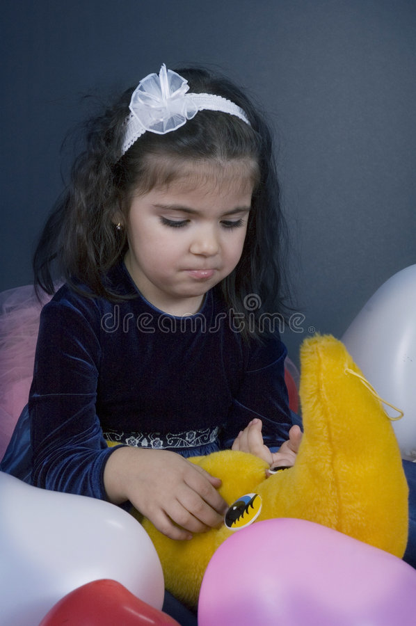 Download Sweet And Sad Young Girl Playing With Her Plush Moon Stock Image - Image: 619377