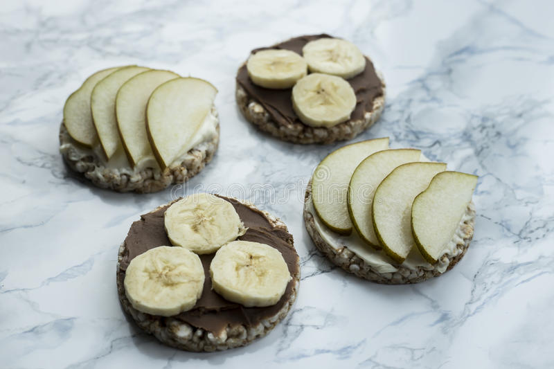 sweet sandwiches with banana and peanut butter on round loaves buckwheat. top view stock images