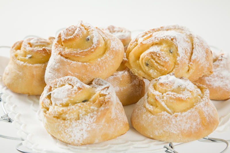 Sweet Savoury buns with white icing. Sweet Savory buns with white icing on tray stock photo