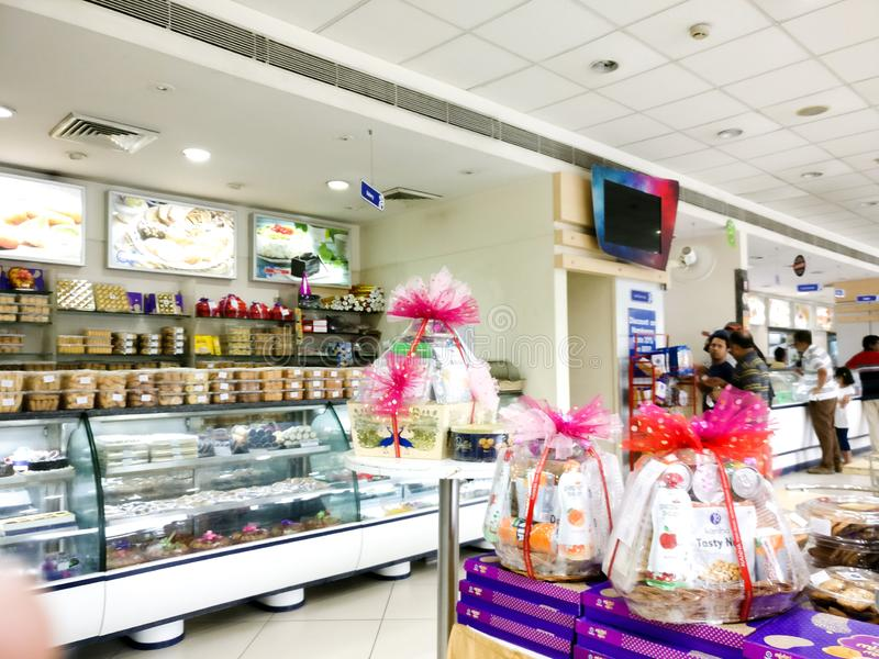 Sweet shop in india with prepacked sweet gift boxes royalty free stock image