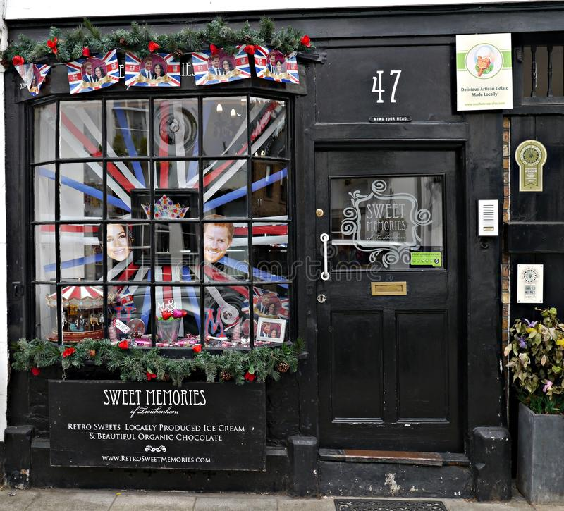 Sweet Shop Window With a Display to Prince Harry and Meghan Markel Upcoming Marriage. An Old fashion sweet shop window in church street twickenham london with stock photography