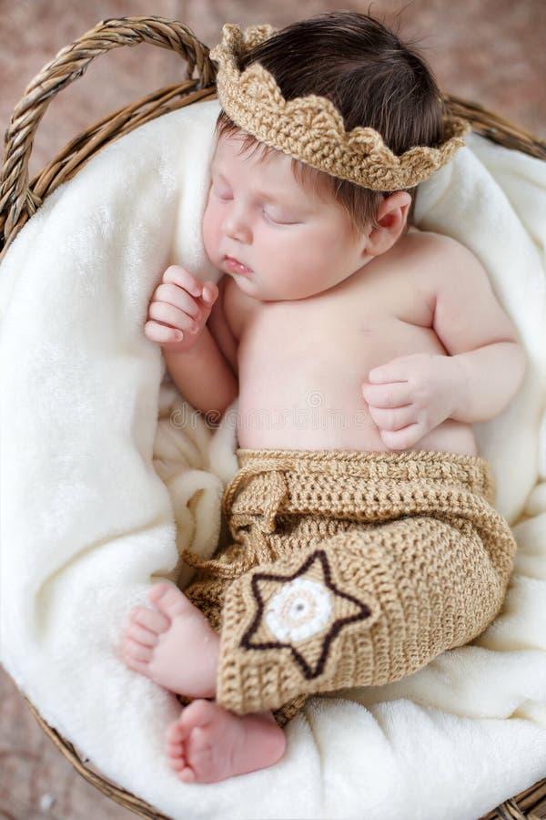 Sweet sleeping newborn baby in wicker basket-collage stock photos