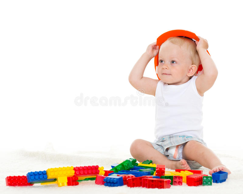 Sweet Small Baby With Helmet And Toys. Royalty Free Stock Photo