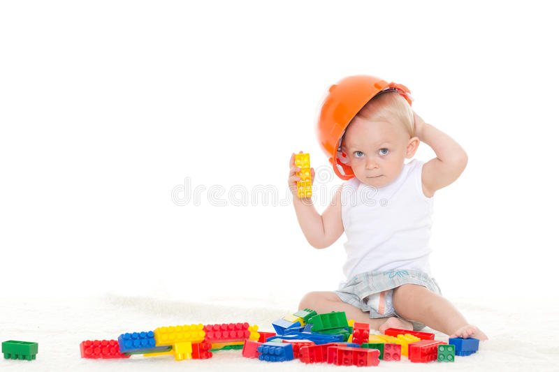 Sweet small baby with helmet and toys. stock image