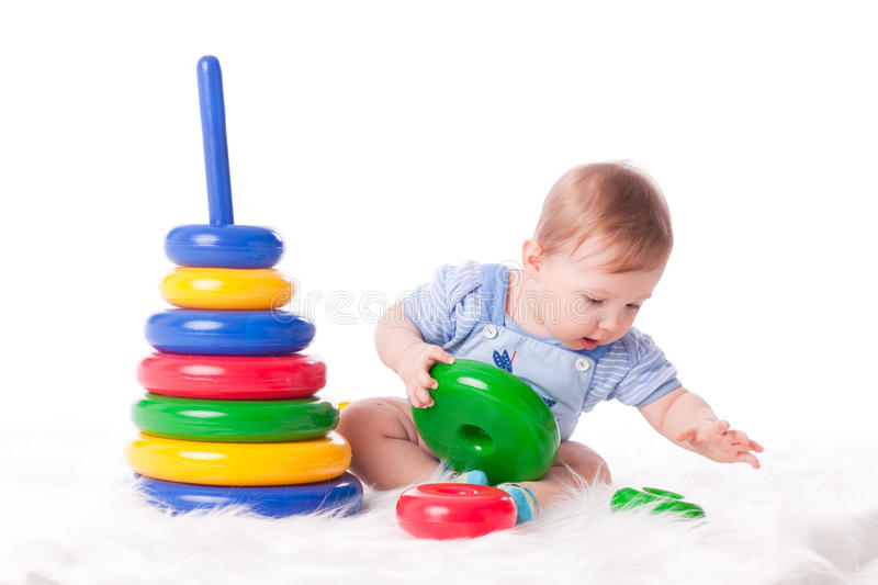 Sweet small baby with toy. royalty free stock images