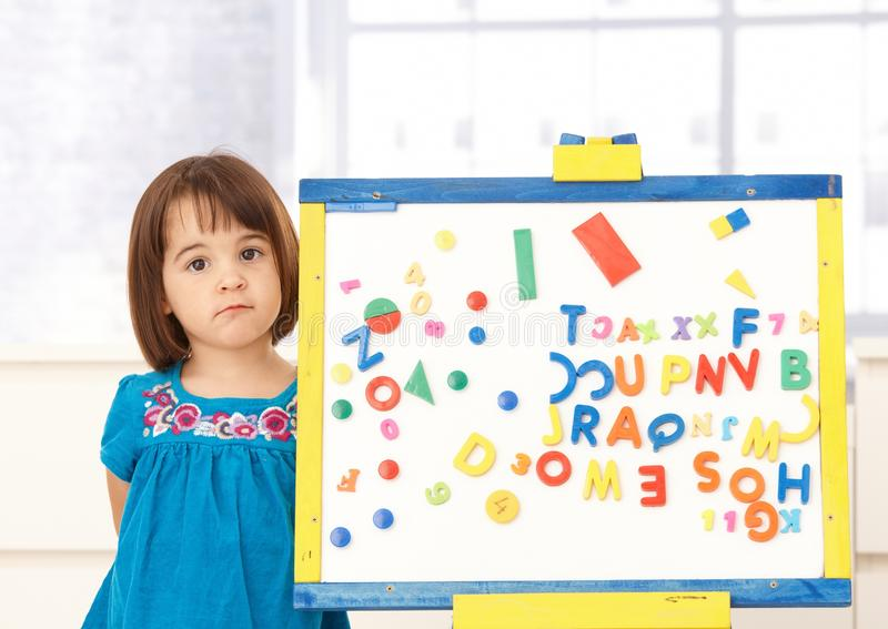 Download Sweet Small Girl Standing At Drawing Board Stock Image - Image: 18075863