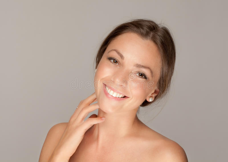 Sweet Smile. A portrait of a happy, pretty woman royalty free stock images