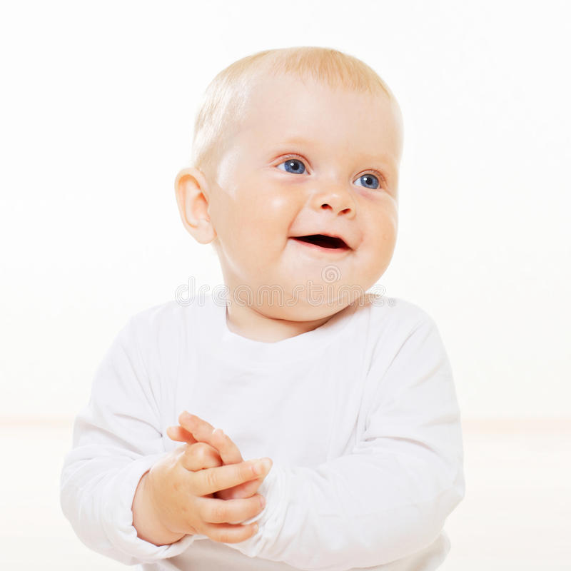 Sweet smiling baby with blue eyes stock photo