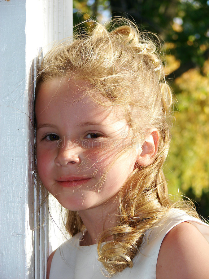 Sweet Smiling Girl. A pretty little blonde girl with a nice smile royalty free stock photos