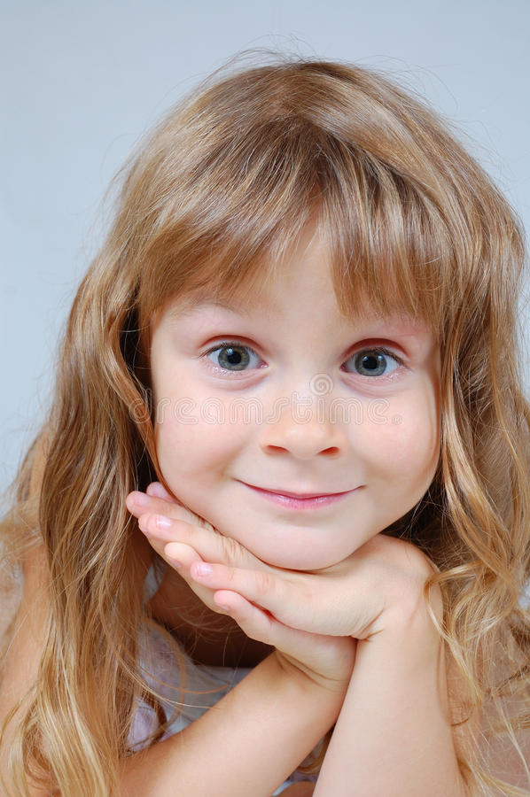 Sweet smiling girl's face stock photography