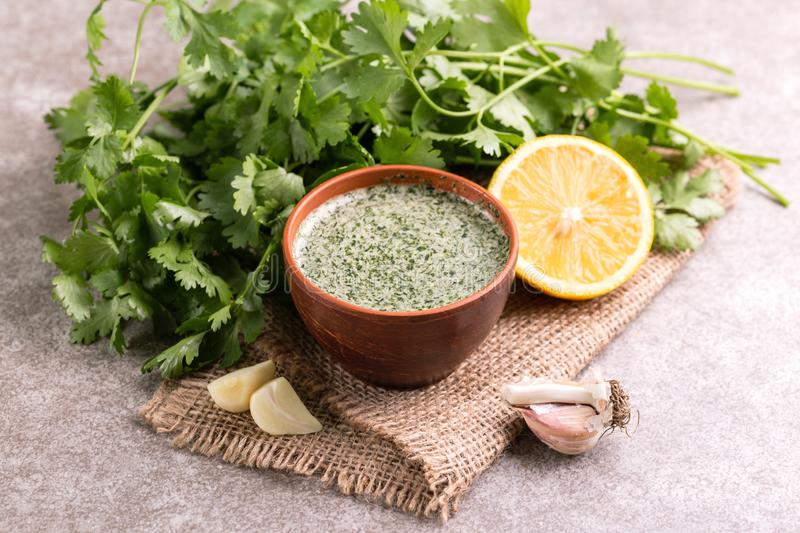 Sweet and sour green homemade sauce with cilantro, lemon and gar royalty free stock photo