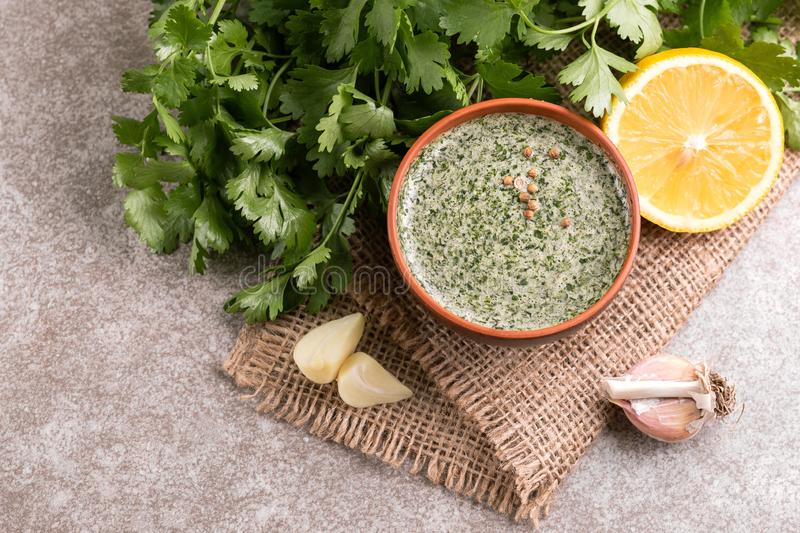 Sweet and sour green homemade sauce with cilantro, lemon and gar royalty free stock photos